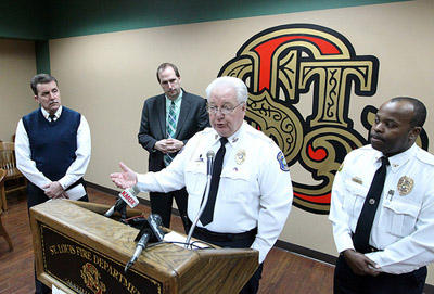 Hazelwood Police Chief Carl Wolf (center) speaks at a press conference about red light cameras today.