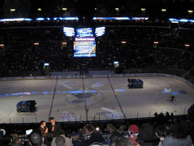 Photo of the Zambonis cleaning the ice at a Blues game at the Scottrade Center