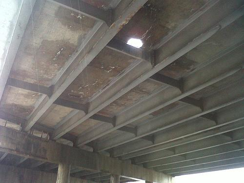 The Delmar bridge over I-170 taken during a MoDOT inspection. Officials say they could have repaired the hole, but the discolored concrete is a big reason for concern.