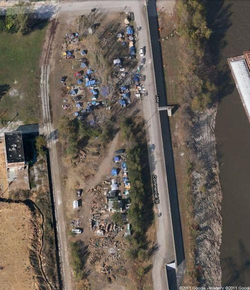 This image from Google Maps shows the encampments along the riverfront. City officials are stepping up efforts to get residents of these encampments into permanent housing.