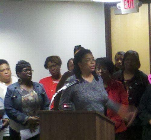 St. Louis Public Schools teacher Alice Lee speaks against possible layoffs of her and other library media specialists in the district. Superintendent Kelvin Adams delayed presenting the budget to have more discussion with the teacher's union.