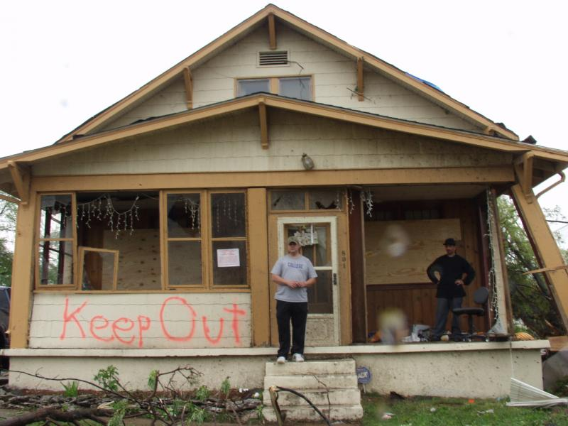 Peter Menke standing in front of his condemned home in Ferguson, Mo.