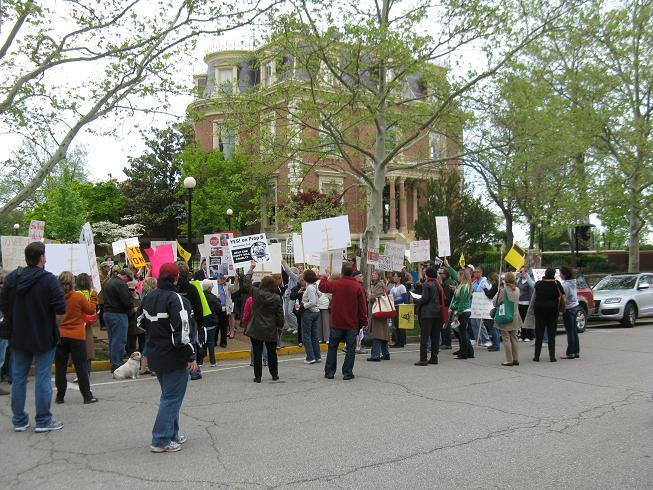 Around a hundred Proposition B supporters rally in front of the Mo. Governor's Mansion, calling on Gov. Nixon to veto Senate Bill 113.