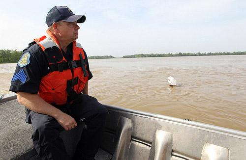 Mo. State Highway Patrol's Roger Shikles keeps watch while passing a mailbox in Butler County, Mo. on April 26, 2011. A levee had breached in the area. A decision to intentionally break a levee in another flood-threatened area, Cairo, Ill. is pending.