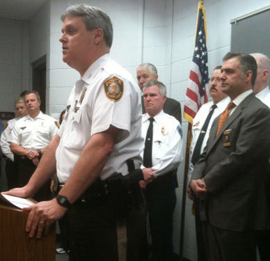 St. Louis County Chief of Police Tim Fitch (standing at podium).