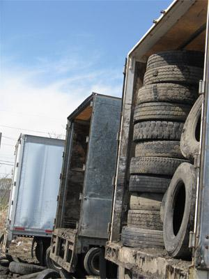 The contractors which will haul away these old tires from a city-owned lot in East St. Louis to be reused are funded with a fee that customers pay on new tires.