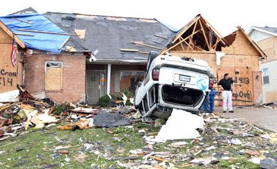 A car remains on its top, three days after a tornado devistated the area of Bridgeton, Missouri on April 25, 2011. The National Weather Service says a EF-4 tornado passed through the northern St. Louis County area, damaging or destroying over 750 homes.