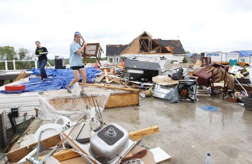 Residents remove belongings three days after a tornado devastated the area of Bridgeton, Missouri on April 25, 2011.