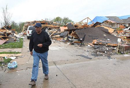 Resident Ron Henderson walks away from his home, totally destroyed, three days after a tornado devastated this area of Bridgeton, Missouri on April 25, 2011. Teams from FEMA are now in the St. Louis area to assess damage from last week's tornadoes.