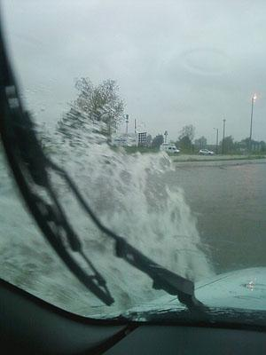 Water streams up the side of a vehicle traveling in Cairo, Ill.
