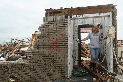 A woman exits her tornado-destroyed home in Joplin, Mo. on May 24.