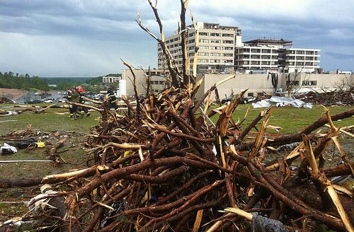 Tree limbs are piled up near Saint John's Hospital in Joplin, Mo. on May 22.