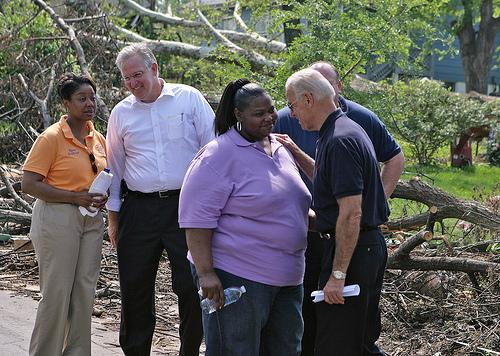 Vice President Joe Biden (R) visits with resident Djuna Miller while Missouri Governor Jay Nixon talks with Mayor Kyra Watson during a tour of tornado damage in Berkeley, Missouri on May 11, 2011.