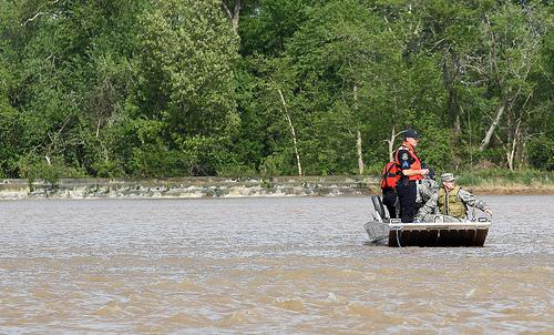 Members of the Missouri State Highway Patrol and Missouri National Guard survey a levy breach in Butler County, Missouri on April 26, 2011. The levee along the Black River has breached in several places, forcing authorities to evacuate residents.