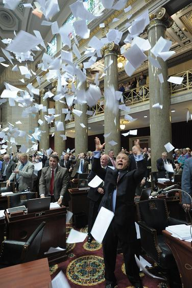 Missouri House members toss copies of bills in the air the moment the gavel came down on the 2011 legislative session.  The final day paper toss is a tradition in the Missouri House.