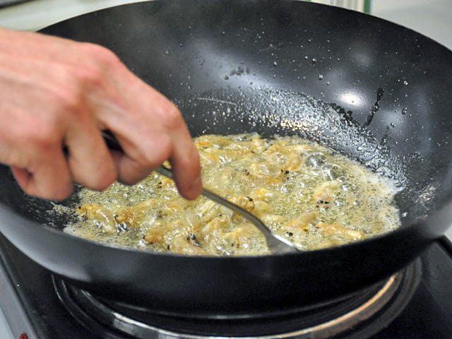 Cicadas frying: Entomologist Chris Hartley sautés up some cicadas in butter and garlic.