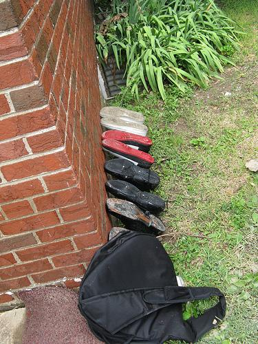 Annie Anderson's son laid his flood-swamped shoes out to dry along the wall of their home.