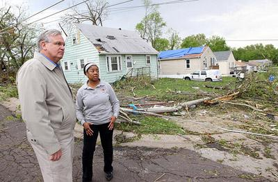 Mo. Gov. Jay Nixon gets a tour of a damaged neighborhood by Berkeley, Mo. Mayor Kyra Watson in St. Louis on April 23, 2011. A tornado hit the region on April 22 damaging or destroying over 750 homes and buildings.