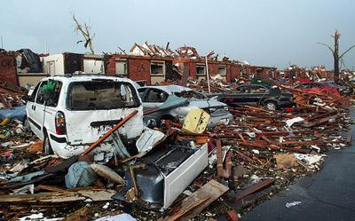 An apartment complex reduced to ruble in Joplin, Mo. on May 23, 2011. The death toll attributed to the May 22 tornado that swept through the area has now reached 151 people.