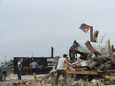 Cleanup of tornado damage in Joplin, Mo. continues, including an effort to recycle electronics damaged in the storm.