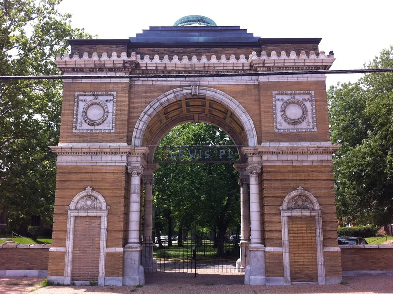 The historic entrance arch to the Lewis Place neighborhood, which will receive state aid nearly a year after a tornado damaged 91 homes in the area.