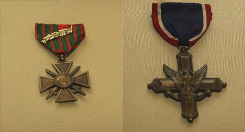 "Maj. Ernest W. Slusher received the Croix de Guerre (l) or ""French Cross of War,"" and the Distinguished Service Cross (r) for his service on the battlefield between Sept. 29 and Sept. 30, 1918."