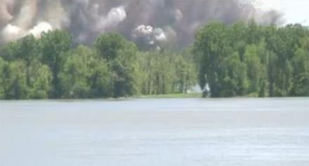 A screen grab still frame of a video by the U.S. Army Corps of Engineers of the second intentional levee blast near New Madrid, Mo. on May 3. The Corps says that water has now stopped flowing through the blasted section because the river has dropped.