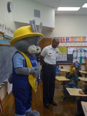 """Sam Safety,"" (left) along with St. Louis Police Chief Dan Isom visit students at Cote Brilliant School. ""Sam"" is the Department's mascot for the ""Officer Friendly"" community outreach program."