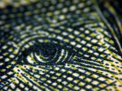 An extreme closeup of U.S. currency.