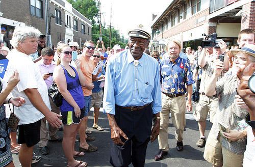 Rock 'n' roll legend Chuck Berry makes his way through a crowd of fans prior to a dedication of a statue of himself in University City, Mo. on July 29, 2011. See more photos in the story below.