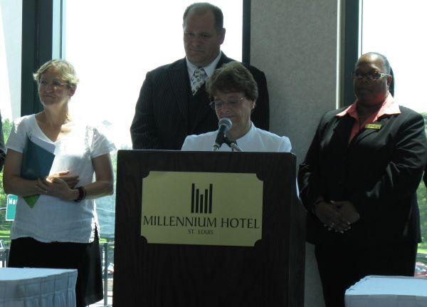 Sister Kathy McCluskey speaks at the signing of the ECPAT code at the Millennium Hotel St. Louis Tuesday. Hotel General Manager Dominic Smart stands behind.