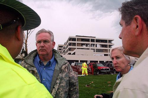 Mo. Gov. Jay Nixon and First Lady Georganne Nixon talk with police outside Saint John's Mercy Hospital in Joplin, Mo. on May 23, 2011. The governor is speaking at a remembrance ceremony this morning at another hospital in town, Freeman Hospital.
