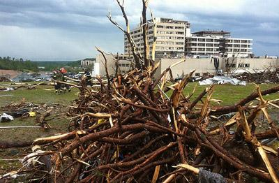 Tree limbs piled up near Saint John's Hospital in Joplin, Mo. on May 22, 2011 after a tornado swept through the area.