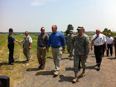 Mo. Gov. Jay Nixon with officers from the Missouri National Guard at the Howell Island Conservation Area outside Chesterfield, Mo. on July 1, 2011.