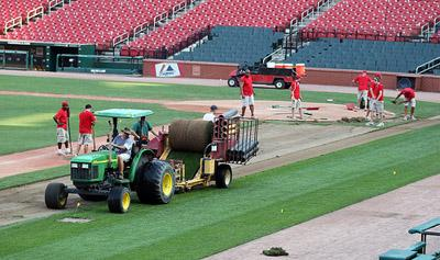Busch Stadium ground crews begin pulling up the playing field in St. Louis on July 10, 2011 as preparations are being made for the U2 concert on July 17. The field will be replaced with new sod for the St. Louis Cardinals when they return home on July 25.