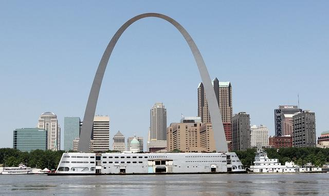The Admiral riverboat is helped down the Mississippi River by the tugboat Michael Luhr past the Gateway Arch in St. Louis on July 19, 2011.