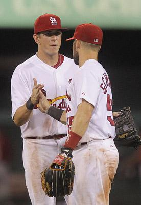 St. Louis Cardinals center fielder Colby Rasmus (L)  is shown celebrating a 3-1 win over the Houston Astros with right fielder Skip Schumaker at Busch Stadium in St. Louis on July 26, 2011. The Cardinals have traded Rasmus to the Toronto Blue Jays.