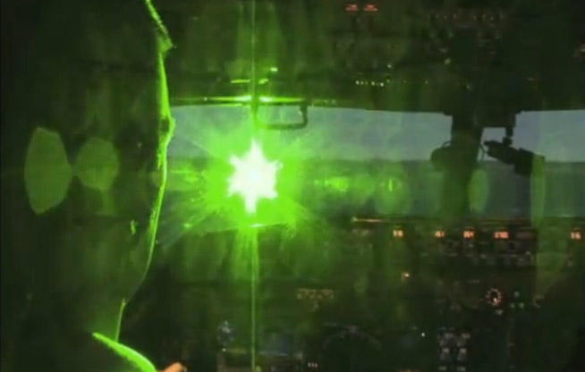 A view from the pilot's seat when a laser beam, like that from a laser pointer, hits the cockpit glass. (Shot in a simulator).