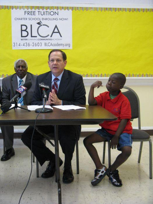 St. Louis Mayor Francis Slay speaks at a July press conference celebrating new charter  Better Learning Communities Academy. Alderman Freeman Bosley, Sr., on the left, with soon-to-be Kindergartener Carl Walker is on the right.