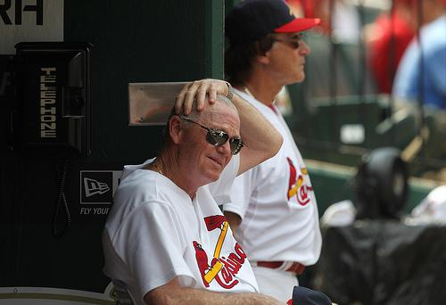 St. Louis Cardinals pitching coach Dave Duncan (L), shown here during a July 10 game against the Arizona Diamondbacks, has taken a leave of absence from the team to be with his wife as she recovers from surgery.
