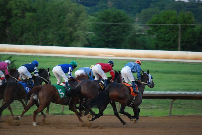 Horses speed around the track at Fairmount Park Racetrack in Collinsville, Ill.