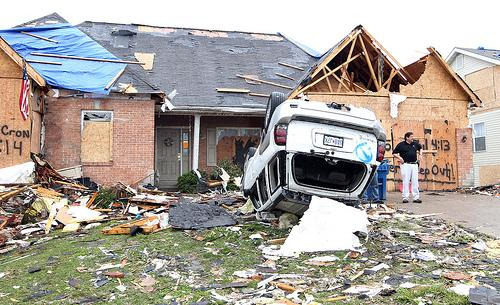 A car remains on its top, three days after a tornado devistated the area of Bridgeton, Missouri on April 25, 2011.