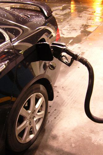 Gas prices were below $3.20 per gallon at some stations in the St. Louis area on Monday. Experts attribute the drop to Standard & Poor's lowered credit rating for the nation.