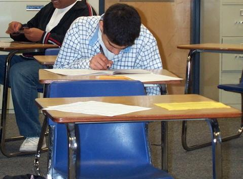 A student taking the ACT exam.