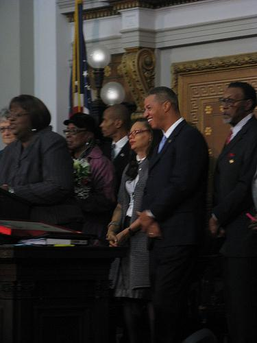 April Ford-Griffin (center, red glasses) listens as Ald. Marlene Davis (at podium) reads a tribute resolution for Ford-Griffin. The former 5th Ward alderwoman stepped down Sept. 30 to take a job leading the St. Louis Civil Rights Enforcement Agency.
