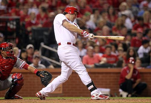 Lance Berkman connects for a three-run homer during a June 23rd blow-out win against the Philadelphia Phillies at Busch Stadium. The Cardinals announced on Thursday that Berkman will return to the team next year.