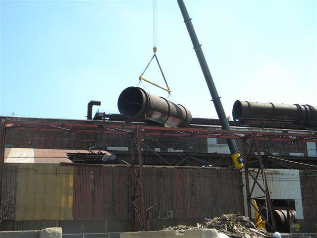 Removing one of the large manifolds from the roof of the foundry building at the former Chemetco secondary copper smelter.