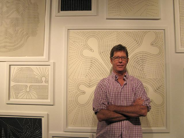 "Artist Greg Edmondson with a number of his graphite drawings, collectively titled ""Simple."""