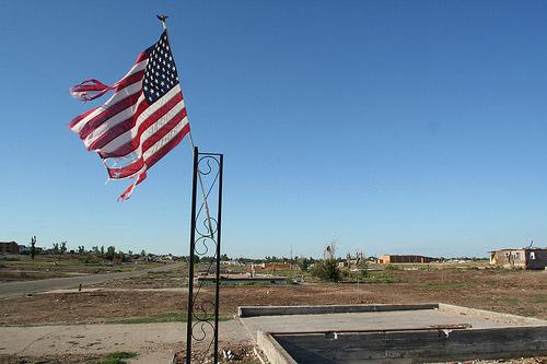 An American flag and foundations from homes are all that remains in a neighborhood in Joplin, Missouri on August 15, 2011. A tornado on May 22, 2011 claimed 162 lives - the latest two of which were announced Wednesday.