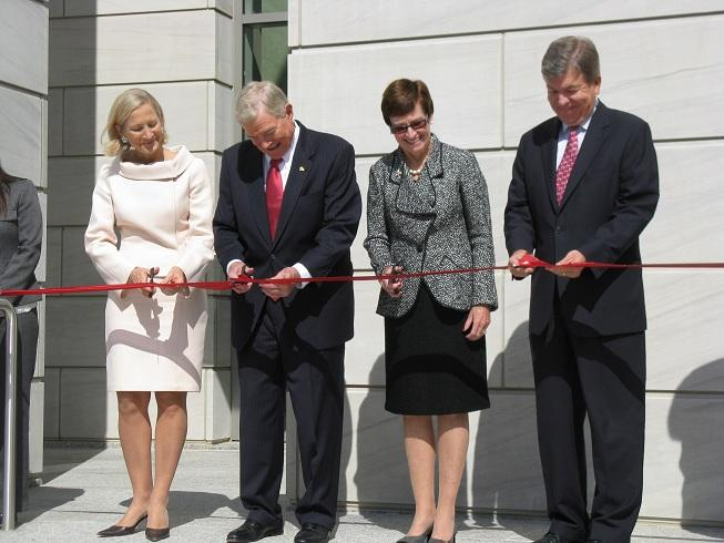 Former Mo. Gov. and U.S. Sen. Kit Bond, cuts the ribbon at a new federal courthouse in Jefferson City named after him.  Joining him (l-r), his wife Linda, U.S. District Judge Nanette Laughrey, and U.S. Sen. Roy Blunt.